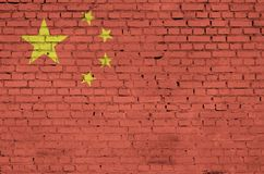 China flag is painted onto an old brick wall stock photos