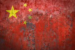 China Flag painted on a Wall. Ddistressed Painting of a Flag on an old Wall Royalty Free Stock Images