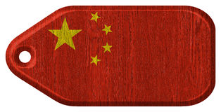 China flag. Painted on wooden tag. isolated on white background royalty free stock photography