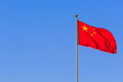 China flag. China red flag on blue sky background Royalty Free Stock Photo