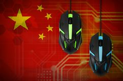 China flag and two mice with backlight. Online cooperative games. Cyber sport team. China flag and two modern computer mice with backlight. The concept of online royalty free stock photography