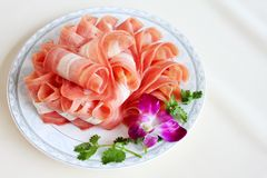China food Sliced mutton. Hot pot with mutton rolls Stock Images