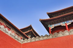 China Forbidden city roof tops. The red and decorated roof tops of Forbidden city imperial palace in Beijing, China, above fortification walls as part of complex royalty free stock photography