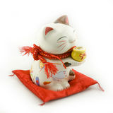China Fortune Cat. A white china fortune cat with red mat stock photography