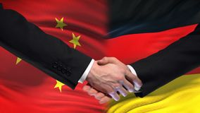 China and Germany handshake, international friendship relations, flag background. Stock footage stock video