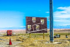 China Ghost Town. Road Sign in English and Chinese Letters royalty free stock photo