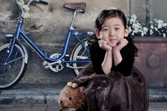 China girl of 1920s. The Chinese girl are wearing 1920s clothes Royalty Free Stock Photo