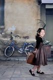 China girl of 1920s with lugga. The girl wearing 1920s clothes and carrying the luggage of the 1920s Royalty Free Stock Photos