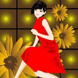 China Girl. A pretty china girl are sitting and making pose in front of flower background Royalty Free Stock Photo