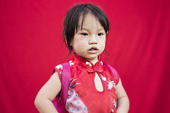 China girl in traditional Chinese red Tang suit greeting Stock Image