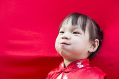 China girl in traditional Chinese red Tang suit greeting Royalty Free Stock Photos