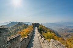 China The great wall distant view compressed towers and wall segments autumn season in mountains near Beijing ancient chinese for. Tification military landmark stock photo