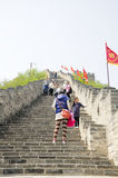 The China Great Wall Tourists. Chinese visitors climbing up the stone steps on the Huanghua Cheng section of the great wall of China in Beijing on a sunny day royalty free stock photography