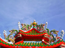 China guardian dragon statue and phoenix bird statue. On top the roof in chinese temple royalty free stock photo