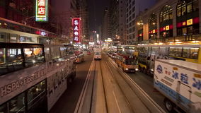 China hong kong central pov tram on busy city streets at night. Video of china hong kong central pov tram on busy city streets at night stock footage