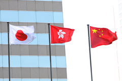 China, Hong Kong and Japan Flags Stock Photography
