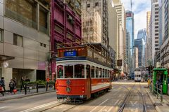 Tourist sightseeing tram in the street of Hong Kong. China, Hong Kong - November 26, 2017: Tourist sightseeing tram in the street of Hong Kong Stock Photos