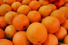 Big juicy oranges on the market counter. royalty free stock photography