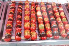 China traditional delicacy. China ice Chinese small food, Tomatoes on sticks, China traditional delicacy Royalty Free Stock Photos