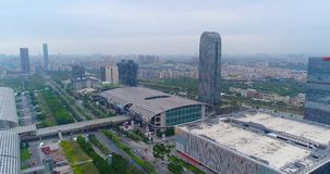 China Import and Export Fair view from the top, the general plan. Flight over the Pazhou Exhibition Complex. International exhibition Canton Fair. Aerial view stock video footage