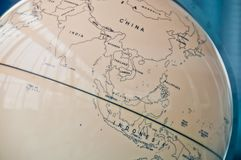 China India and South East Asia countries map in a retro old classic vintage Earth globe in executive management board room. China India and South East Asia royalty free stock photo