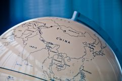 China India and South East Asia countries map in a retro old classic vintage Earth globe in executive management board room royalty free stock image