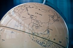 China India and South East Asia countries map in a retro old classic vintage Earth globe in executive management board room.  royalty free stock image