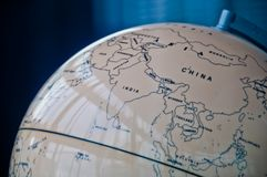 China India and South East Asia countries map in a retro old classic vintage Earth globe in executive management board room. China India and South East Asia royalty free stock photos