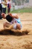 China: Juegos del atletismo del estudiante/salto de longitud Fotografía de archivo libre de regalías