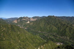 China, Juyongguan. Landscape with a mountain valley. In the background is visible section of the Great Wall of China Stock Photography