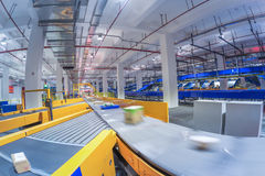 China Logistics Automatic Sorting System. In China, large-scale logistics sorting center line interior stock photography