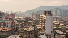 China ligera del lapso de tiempo del panorama 4k del tejado del bloque de la vida de la puesta del sol de Macao almacen de metraje de vídeo