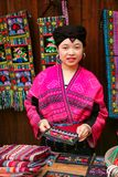 The long-haired woman of the Yao people sells souvenirs to tourists. royalty free stock photos