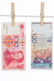 China and Malaysia Currency on Clothesline Royalty Free Stock Image