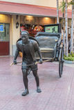 China man and Rickshaw statue. Stock Photos