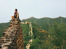 China - Man sitting on the Great Wall stock photos
