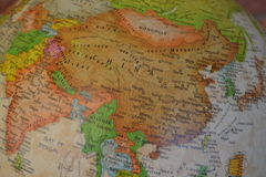 China map on the globe. China pictured on world globe stock images