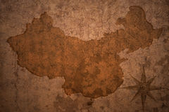 China map on vintage paper background. China map on a old vintage crack paper background royalty free stock photography