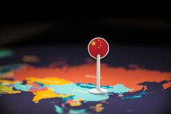 China marked with a flag on the map.  stock image