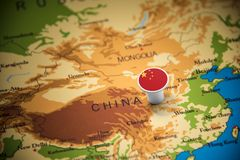 China marked with a flag on the map.  stock photography