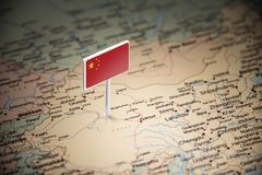 China marked with a flag on the map.  royalty free stock image
