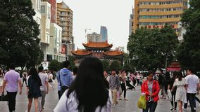 Still shot of people passing by in Kunming city in China. China is the most populated country in the world with the number of 1,3 billion people. Cities of all stock footage