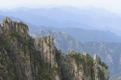 China Mount Huangshan with green trees and beautiful rocks Stock Photography