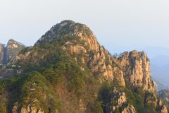 China Mount Huangshan with green trees and beautiful rocks Stock Photo