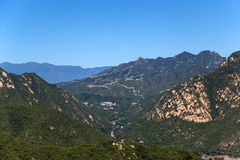 China. Mountain landscape with a view of the Great Wall, snaking on the hillside Royalty Free Stock Image
