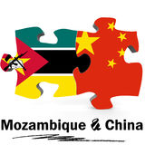 China and Mozambique flags in puzzle Royalty Free Stock Photography