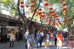 China : Nanluoguxiang. Nanluoguxiang was built in the Yuan Dynasty and received its current name during the Qing Dynasty. The hutong has become a popular tourist Royalty Free Stock Photo