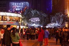 China: Night strolling. CHONGQING, CHINA - DEC 25: Busy chinese street on Christmas day in  Chongqing, Dec 25, 2010. The city has been  decorated with Christmas Stock Photo