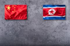 China and North korea flag on concrete background royalty free stock images