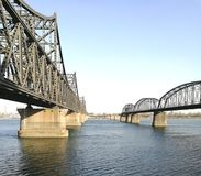 China - North Korea Friendship bridge left; and the Broken Bridge right, across the Yalu river. Taken in April, 2017, from public area in Dandong, Liaoning Royalty Free Stock Image